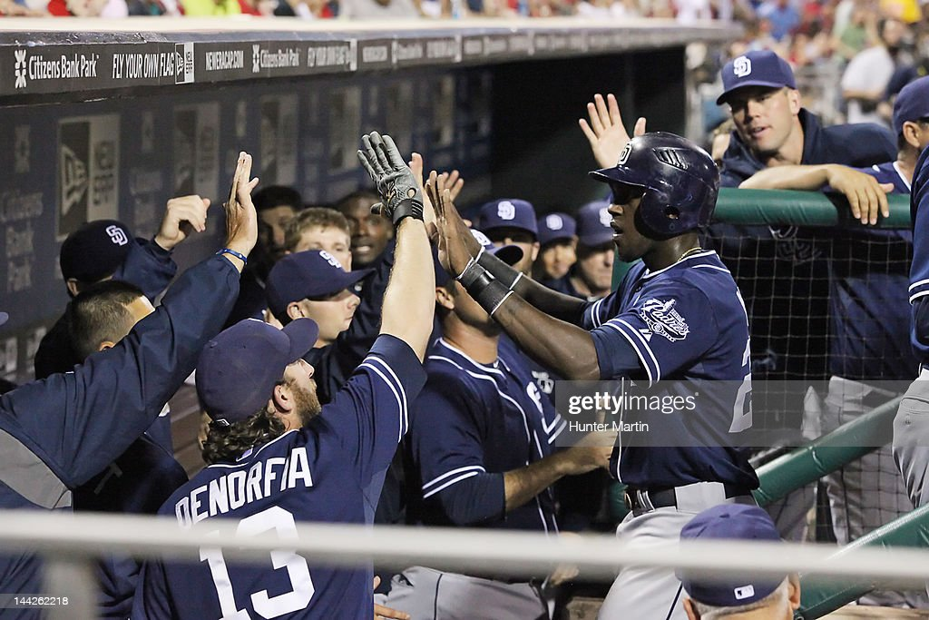 Center fielder <a gi-track='captionPersonalityLinkClicked' href=/galleries/search?phrase=Cameron+Maybin&family=editorial&specificpeople=2364846 ng-click='$event.stopPropagation()'>Cameron Maybin</a> #24 of the San Diego Padres is congratulated by teammates after scoring a run during a game against the Philadelphia Phillies at Citizens Bank Park on May 12, 2012 in Philadelphia, Pennsylvania.