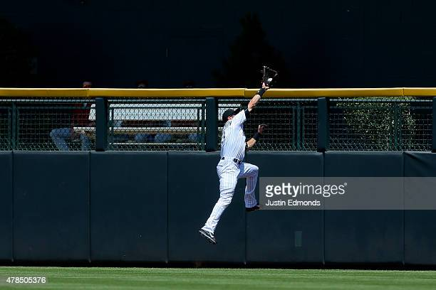 Center fielder Charlie Blackmon of the Colorado Rockies makes a leaping catch at the wall on a ball off the bat Nick Ahmed of the Arizona...