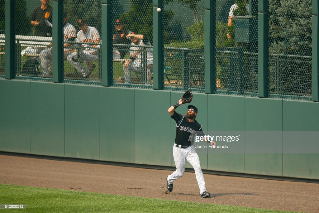 Center fielder Charlie Blackmon #19 of the Colorado Rockies makes a catch on the warning track for the first out of the fifth inning against the San Francisco Giants at Coors Field on September 4, 2017 in Denver, Colorado. The Rockies defeated the Giants 4-3.