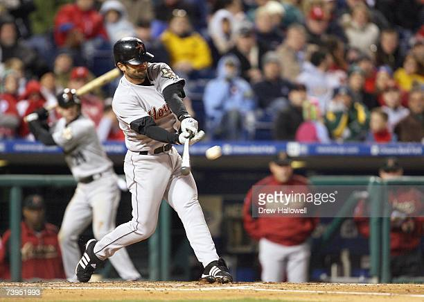 Center fielder Chris Burke of the Houston Astros hits a grand slam during the game against the Philadelphia Phillies on April 13 2007 at Citizens...