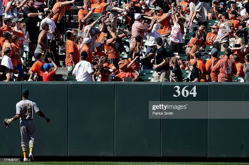 Center fielder Chris Young #25 of the Oakland Athletics watches as a home run hit by J.J. Hardy #2 of the Baltimore Orioles sails into the crowd in the sixth inning at Oriole Park at Camden Yards on August 25, 2013 in Baltimore, Maryland.