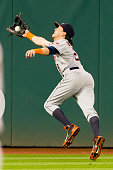 Center fielder Colby Rasmus of the Houston Astros catches a fly ball hit by Michael Bourn of the Cleveland Indians during the fifth inning at...