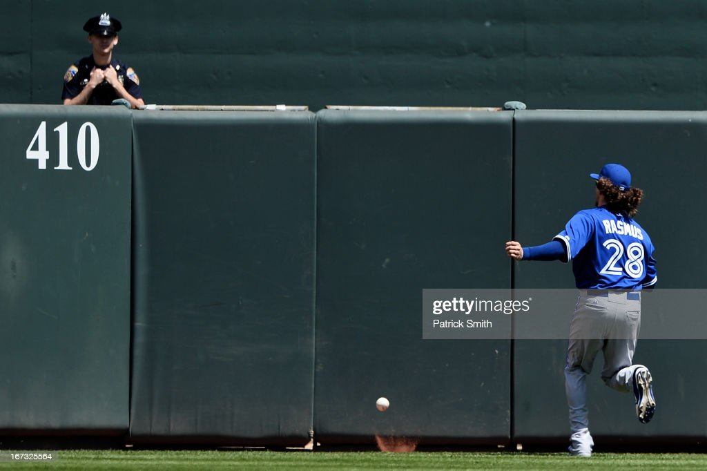 Center fielder Colby Rasmus #28 of the Toronto Blue Jays watches a ground rule double hit by batter Nate McLouth #9 of the Baltimore Orioles (not pictured) bounce over the outfield wall in the first inning at Oriole Park at Camden Yards on April 24, 2013 in Baltimore, Maryland.