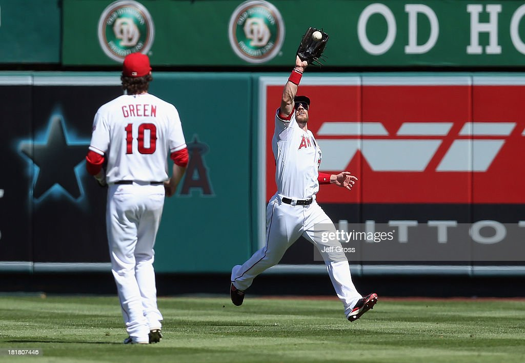Center fielder <a gi-track='captionPersonalityLinkClicked' href=/galleries/search?phrase=Collin+Cowgill&family=editorial&specificpeople=6888953 ng-click='$event.stopPropagation()'>Collin Cowgill</a> #19 of the Los Angeles Angels of Anaheim makes a catch on a ball hit by Josh Reddick of the Oakland Athletics in the fourth inning at Angel Stadium of Anaheim on September 25, 2013 in Anaheim, California.