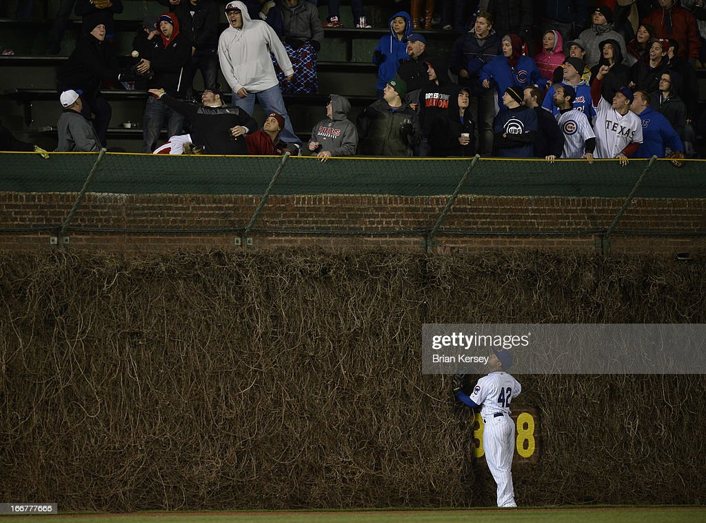 Center fielder <a gi-track='captionPersonalityLinkClicked' href=/galleries/search?phrase=Dave+Sappelt&family=editorial&specificpeople=7510516 ng-click='$event.stopPropagation()'>Dave Sappelt</a> of the Chicago Cubs watches as a two-run home run hit by Adrian Beltre of the Texas Rangers leaves the park in the eighth inning at Wrigley Field on April 16, 2013 in Chicago, Illinois. Elvis Andrus of the Texas Rangers scored on the home run. All uniformed team members are wearing jersey number 42 in honor of Jackie Robinson Day.