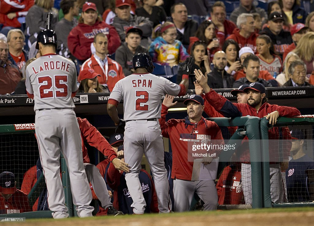 Center fielder Denard Span #2 of the Washington Nationals scores a run and receives high fives from his teammates in the eighth inning against the Philadelphia Phillies on May 2, 2014 at Citizens Bank Park in Philadelphia, Pennsylvania.