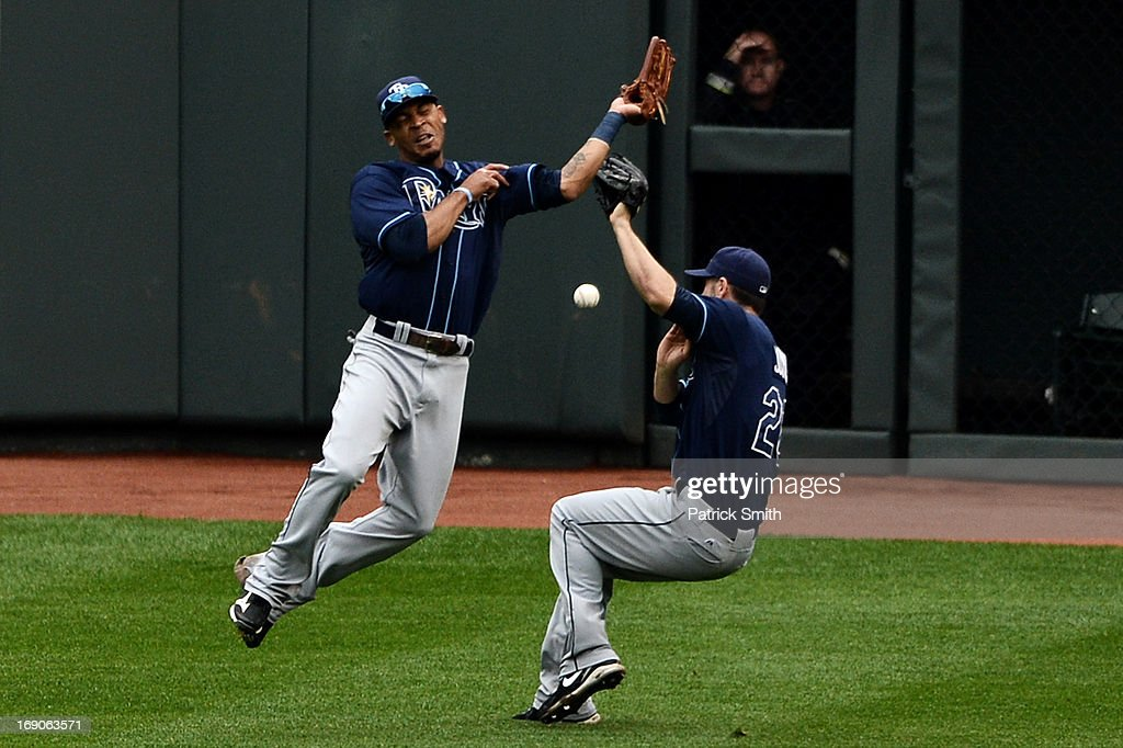 Center fielder Desmond Jennings #8 of the Tampa Bay Rays (left) and teammate Matt Joyce #20 almost collide as they miss a hit to the outfield against the Baltimore Orioles in the fourth inning at Oriole Park at Camden Yards on May 19, 2013 in Baltimore, Maryland.