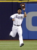 Center fielder Desmond Jennings of the Tampa Bay Rays hauls in the fly ball by Casey McGehee of the Miami Marlins to end the top of the first inning...