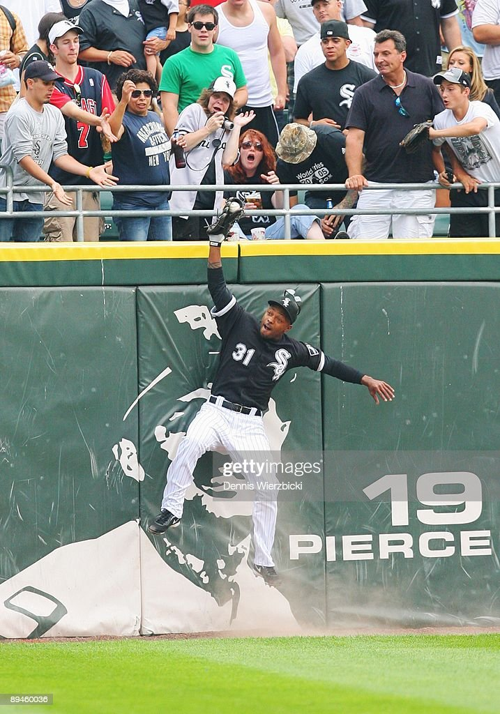 Center fielder Dewayne Wise #31 of the Chicago White Sox leaps over the wall to catch a ball hit by right fielder Gabe Kapler of the Tampa Bay Rays (not pictured) preserving pitcher Mark Buehrle's perfect game in the ninth inning of an MLB game on July 23, 2009 at US Cellular Field in Chicago, Illinois. The White Sox won 5-0. Sequence 3 of 4.