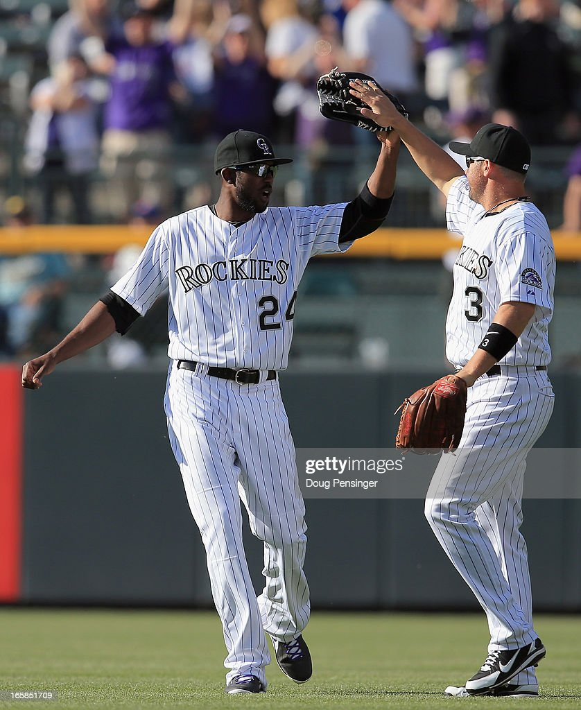 Center fielder <a gi-track='captionPersonalityLinkClicked' href=/galleries/search?phrase=Dexter+Fowler&family=editorial&specificpeople=4949024 ng-click='$event.stopPropagation()'>Dexter Fowler</a> #24 of the Colorado Rockies and right fielder <a gi-track='captionPersonalityLinkClicked' href=/galleries/search?phrase=Michael+Cuddyer&family=editorial&specificpeople=208127 ng-click='$event.stopPropagation()'>Michael Cuddyer</a> #3 of the Colorado Rockies celebrate their victory over the San Diego Padres during Opening Day at Coors Field on April 5, 2013 in Denver, Colorado. The Rockies defeated the Padres 5-2.