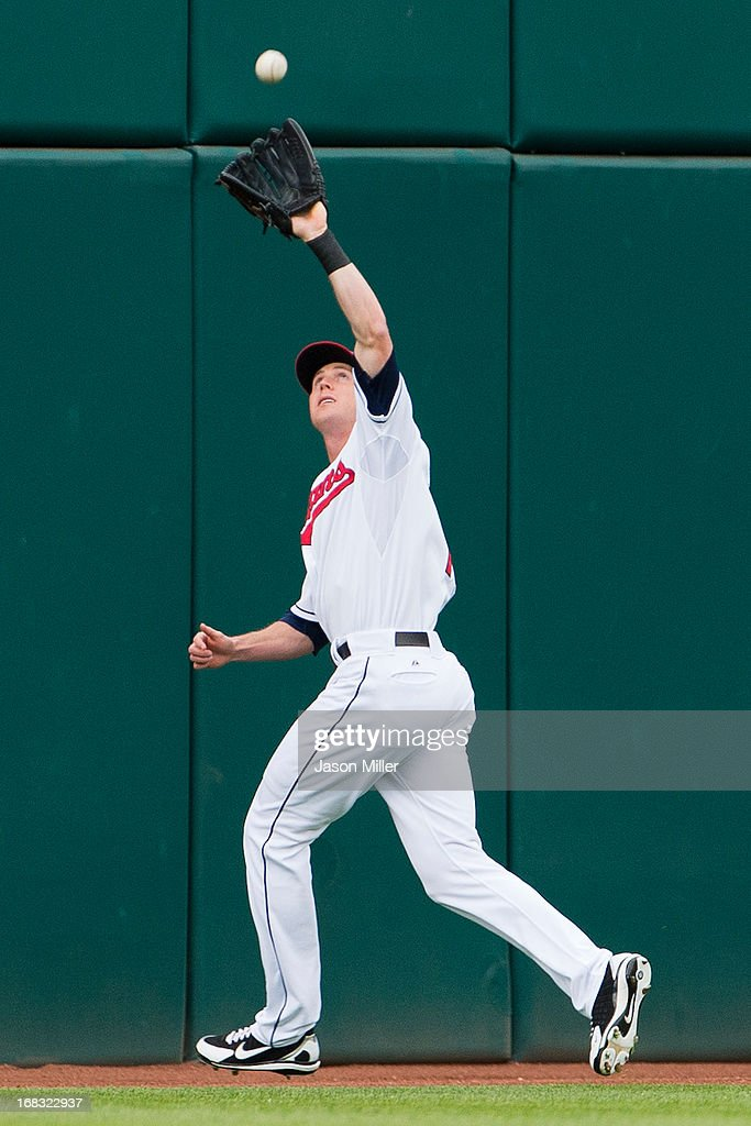 Center fielder Drew Stubbs #11 of the Cleveland Indians catches a fly ball hit by Brandon Moss #37 of the Oakland Athletics during the second inning at Progressive Field on May 8, 2013 in Cleveland, Ohio.