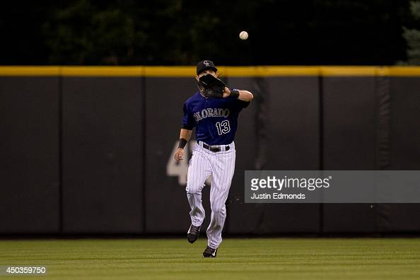 Center fielder Drew Stubbs of the Colorado Rockies makes a catch on a ball off the bat of Jason Heyward of the Atlanta Braves during the ninth inning...