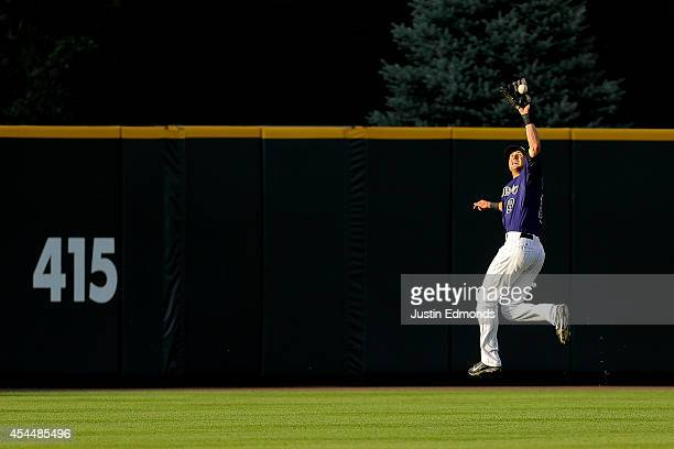 Center fielder Drew Stubbs of the Colorado Rockies makes a leaping catch for the second out of the eighth inning on a ball off the bat of Hunter...
