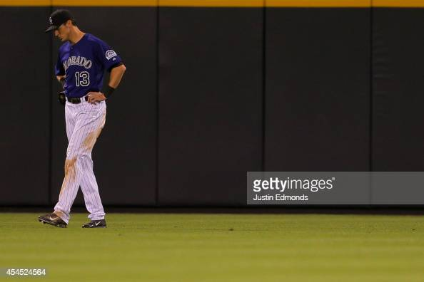 Center fielder Drew Stubbs of the Colorado Rockies reacts after dropping a line drive during the eighth inning against the San Francisco Giants at...