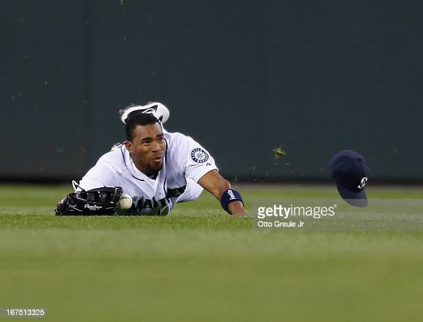 Center fielder Endy Chavez of the Seattle Mariners just misses making a diving catch on a ball hit by Luis Jimenez of the Los Angeles Angels of...