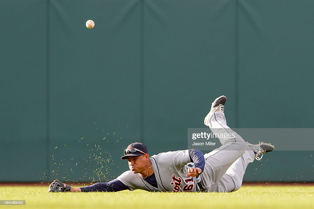 Center fielder Ezequiel Carrera #61 of the Detroit Tigers misses on a diving catch hit by Zach Walters #6 of the Cleveland Indians during the sixth inning a Progressive Field on September 1, 2014 in Cleveland, Ohio.