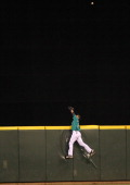 Center fielder Franklin Gutierrez of the Seattle Mariners leaps for a two run homer by Freddie Freeman of the Atlanta Braves in the seventh inning at...