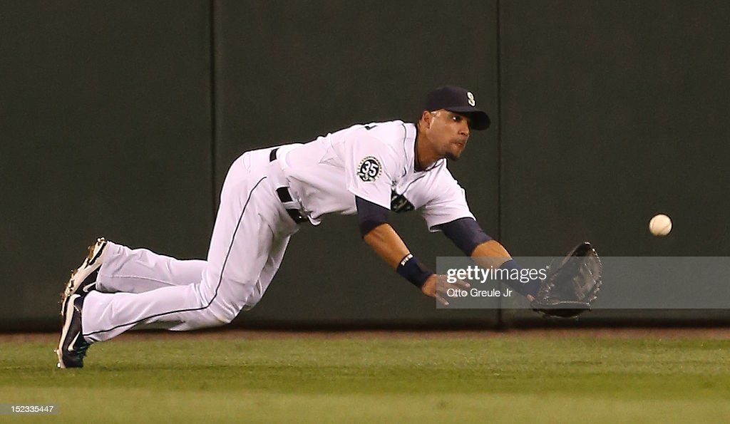 Center fielder <a gi-track='captionPersonalityLinkClicked' href=/galleries/search?phrase=Franklin+Gutierrez&family=editorial&specificpeople=837650 ng-click='$event.stopPropagation()'>Franklin Gutierrez</a> #21 of the Seattle Mariners makes a diving attempt to catch a double hit by Nate McLouth of the Baltimore Orioles in the sixth inning at Safeco Field on September 18, 2012 in Seattle, Washington.