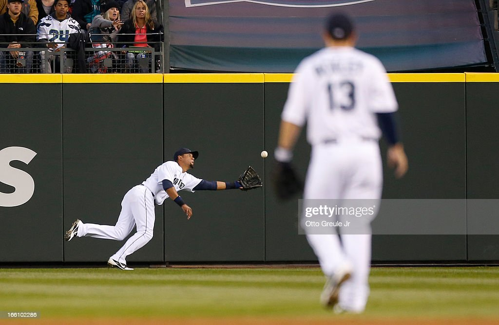 Center fielder <a gi-track='captionPersonalityLinkClicked' href=/galleries/search?phrase=Franklin+Gutierrez&family=editorial&specificpeople=837650 ng-click='$event.stopPropagation()'>Franklin Gutierrez</a> #21 of the Seattle Mariners makes a diving catch in the third inning on a ball hit by Ronny Cedeno of the Houston Astros on Opening Day at Safeco Field on April 8, 2013 in Seattle, Washington.
