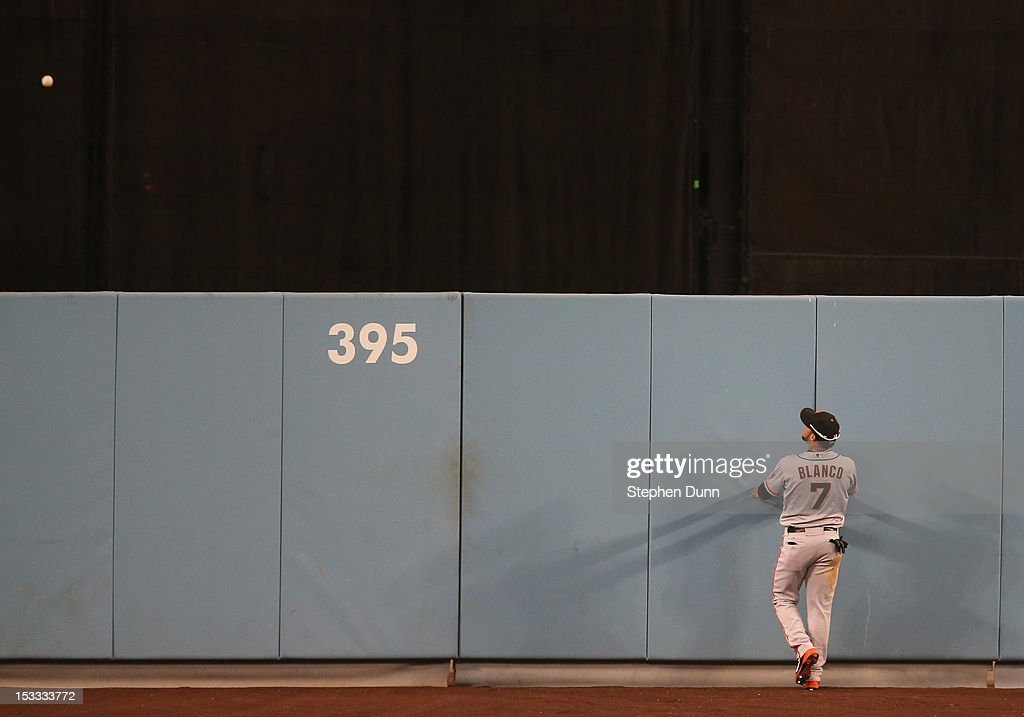 Center fielder <a gi-track='captionPersonalityLinkClicked' href=/galleries/search?phrase=Gregor+Blanco&family=editorial&specificpeople=4137600 ng-click='$event.stopPropagation()'>Gregor Blanco</a> #7 of the San Francisco Giants watches as a ninth inning two run home run hit by Juna Rivera of the Los Angeles Dodgers clears the wall on October 3, 2012 at Dodger Stadium in Los Angeles, California. The Dodgers won 5-1.