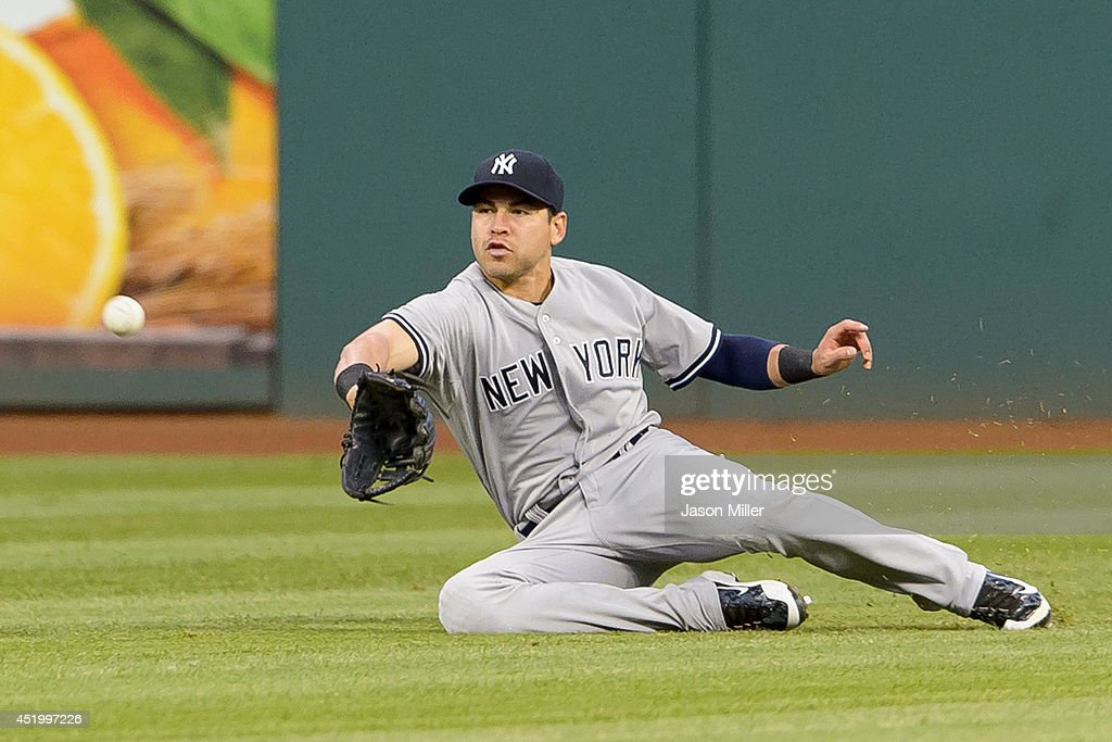 Center fielder <a gi-track='captionPersonalityLinkClicked' href=/galleries/search?phrase=Jacoby+Ellsbury&family=editorial&specificpeople=4172583 ng-click='$event.stopPropagation()'>Jacoby Ellsbury</a> #22 of the New York Yankees catches a fly ball hit by Carlos Santana #41 of the Cleveland Indians to end the fifth inning at Progressive Field on July 10, 2014 in Cleveland, Ohio.