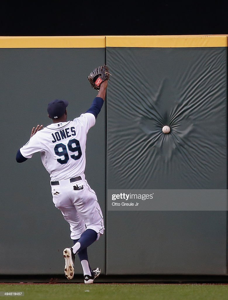 Center fielder James Jones #99 of the Seattle Mariners chases down a triple off the bat of C.J. Cron of the Los Angeles Angels of Anaheim in the fourth inning at Safeco Field on May 29, 2014 in Seattle, Washington.