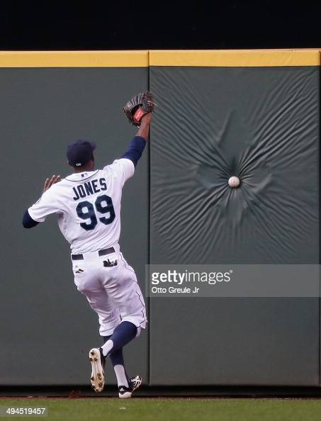 Center fielder James Jones of the Seattle Mariners chases down a triple off the bat of CJ Cron of the Los Angeles Angels of Anaheim in the fourth...