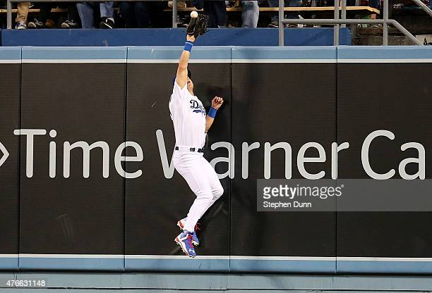 Center fielder Joc Pederson of the Los Angeles Dodgers jumps at the wall to catch a drive off the bat of Yasmany Tomas of the Arizona Diamondbacks...