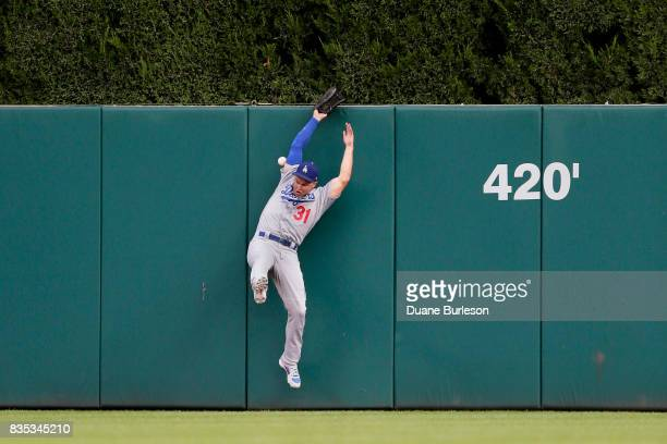 Center Fielder Joc Pederson of the Los Angeles Dodgers misplays a fly ball hit to the center field wall by Justin Upton of the Detroit Tigers during...