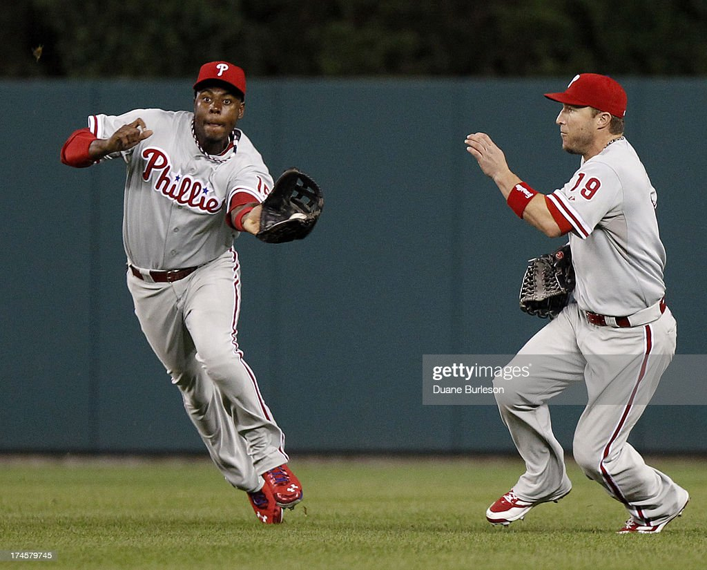 Center fielder John Mayberry #15 of the Philadelphia Phillies catches a fly ball hit by Hernan Perez #26 of the Detroit Tigers as right fielder <a gi-track='captionPersonalityLinkClicked' href=/galleries/search?phrase=Laynce+Nix&family=editorial&specificpeople=214636 ng-click='$event.stopPropagation()'>Laynce Nix</a> #19 avoids the play in the seventh inning at Comerica Park on July 27, 2013 in Detroit, Michigan.