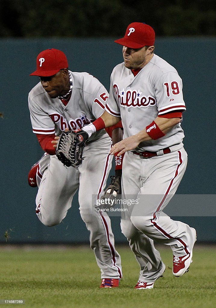 Center fielder John Mayberry #15 of the Philadelphia Phillies tries to avoid colliding with right fielder <a gi-track='captionPersonalityLinkClicked' href=/galleries/search?phrase=Laynce+Nix&family=editorial&specificpeople=214636 ng-click='$event.stopPropagation()'>Laynce Nix</a> #19 after catching a fly ball hit by Hernan Perez of the Detroit Tigers in the seventh inning at Comerica Park on July 27, 2013 in Detroit, Michigan.