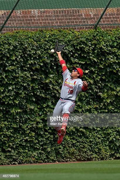 Center fielder Jon Jay of the St Louis Cardinals cannot get to a double hit by Welington Castillo of the Chicago Cubs during the third inning at...