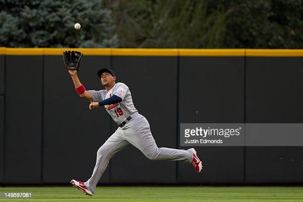 Center fielder Jon Jay of the St Louis Cardinals makes a catch on the run for the third out of the second inning against the Colorado Rockies at...