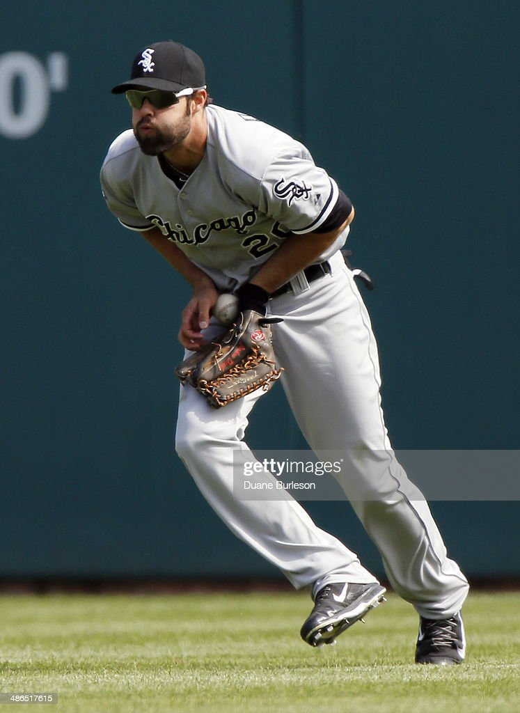 Center fielder <a gi-track='captionPersonalityLinkClicked' href=/galleries/search?phrase=Jordan+Danks&family=editorial&specificpeople=2364706 ng-click='$event.stopPropagation()'>Jordan Danks</a> #20 of the Chicago White Sox fields a single off the bat of Bryan Holaday of the Detroit Tigers in the eighth inning at Comerica Park on April 24, 2014 in Detroit, Michigan.