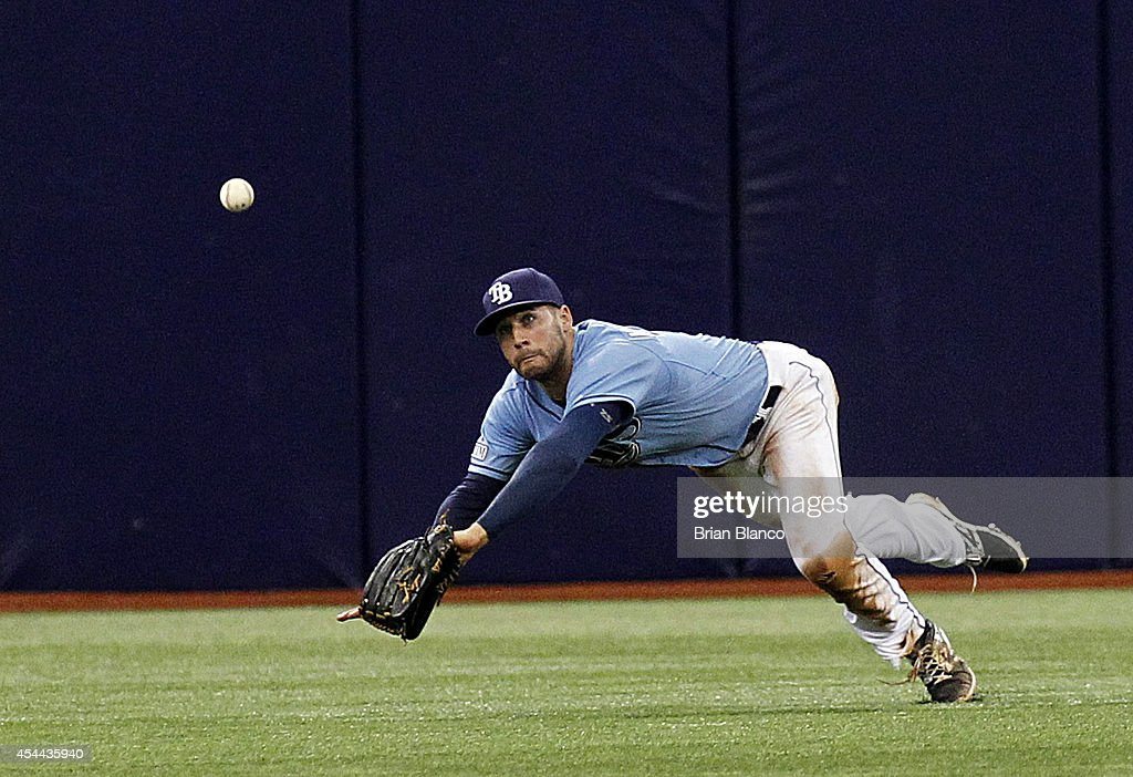 Center fielder Kevin Kiermaier #39 of the Tampa Bay Rays fails to come up with the double by Mookie Betts #50 of the Boston Red Sox during the eighth inning of a game on August 31, 2014 at Tropicana Field in St. Petersburg, Florida.