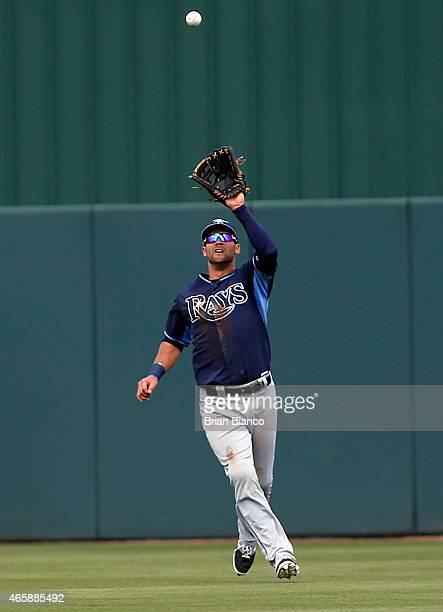 Center fielder Kevin Kiermaier of the Tampa Bay Rays hauls in the pop up by Joe Mauer of the Minnesota Twins during the third inning of a spring...