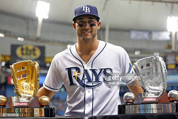 Center fielder Kevin Kiermaier of the Tampa Bay Rays poses with his Golden Glove Award and his Platinum Glove Award after being presented with both...