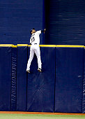 Center fielder Kevin Kiermaier of the Tampa Bay Rays watches the tworun home run by Greg Bird of the New York Yankees go over the outfield wall...