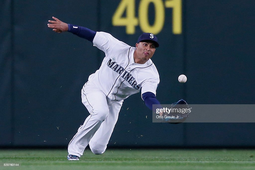 Center fielder Leonys Martin #12 of the Seattle Mariners makes a sliding catch on a ball off the bat of Ryan Rua of the Texas Rangers to start a double play which ended the top of the sixth inning at Safeco Field on April 12, 2016 in Seattle, Washington.