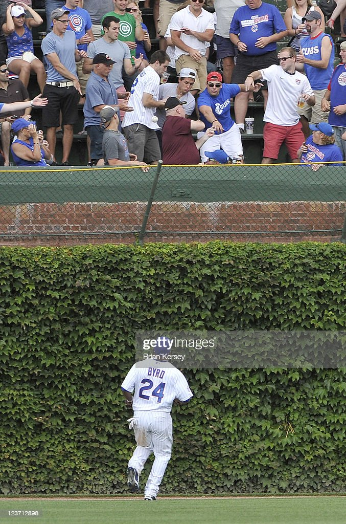 Center fielder Marlon Byrd #24 of the Chicago Cubs watches as a two-run home run hit by Neil Walker #18 of the Pittsburgh Pirates scoring Derrek Lee #25 leaves the ballpark during the eighth inning at Wrigley Field on September 4, 2011 in Chicago, Illinois.