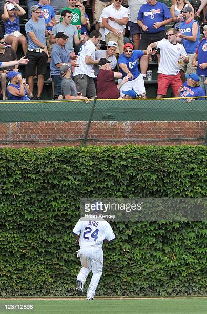 Center fielder Marlon Byrd of the Chicago Cubs watches as a tworun home run hit by Neil Walker of the Pittsburgh Pirates scoring Derrek Lee leaves...