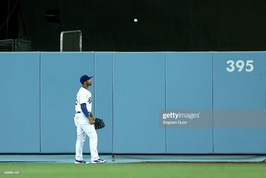 Center fielder Matt Kemp #27 of the Los Angeles Dodgers reacts as a three run home run ball hit by Nick Castellanos of the Detroit Tigers bounces on the other side of the wall at Dodger Stadium on April 9, 2014 in Los Angeles, California.
