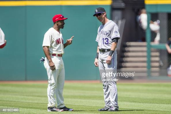 Center fielder Michael Bourn of the Cleveland Indians and former Indians center fielder Drew Stubbs of the Colorado Rockies talk on the field prior...