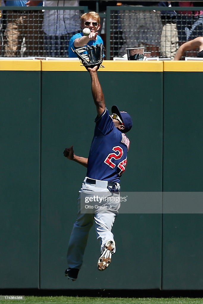 Center fielder <a gi-track='captionPersonalityLinkClicked' href=/galleries/search?phrase=Michael+Bourn&family=editorial&specificpeople=835742 ng-click='$event.stopPropagation()'>Michael Bourn</a> #24 of the Cleveland Indians catches a fly ball by Kyle Seager of the Seattle Mariners in the first inning at Safeco Field on July 24, 2013 in Seattle, Washington. Cleveland defeated the Mariners 10-1.