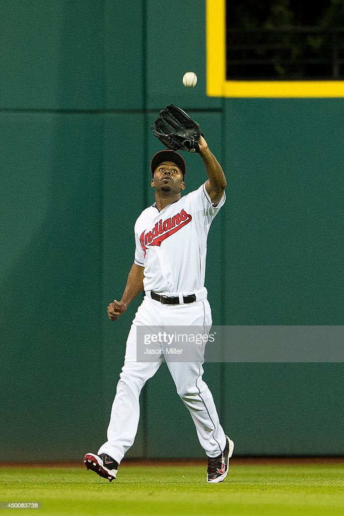 Center fielder <a gi-track='captionPersonalityLinkClicked' href=/galleries/search?phrase=Michael+Bourn&family=editorial&specificpeople=835742 ng-click='$event.stopPropagation()'>Michael Bourn</a> #24 of the Cleveland Indians catches a fly ball off the bat of Xander Bogaerts (not pictured) of the Boston Red Sox during the first inning at Progressive Field on June 4, 2014 in Cleveland, Ohio.