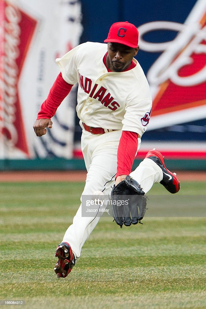 Center fielder <a gi-track='captionPersonalityLinkClicked' href=/galleries/search?phrase=Michael+Bourn&family=editorial&specificpeople=835742 ng-click='$event.stopPropagation()'>Michael Bourn</a> #24 of the Cleveland Indians fields a ground ball hit off the bat of <a gi-track='captionPersonalityLinkClicked' href=/galleries/search?phrase=Brett+Gardner&family=editorial&specificpeople=4172518 ng-click='$event.stopPropagation()'>Brett Gardner</a> of the New York Yankees during the fourth inning on opening day at Progressive Field on April 8, 2013 in Cleveland, Ohio.