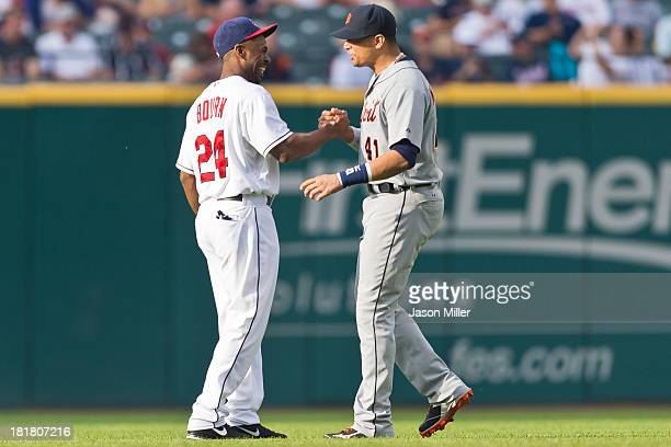 Center fielder Michael Bourn of the Cleveland Indians greets designated hitter Victor Martinez of the Detroit Tigers at Progressive Field on July 5...