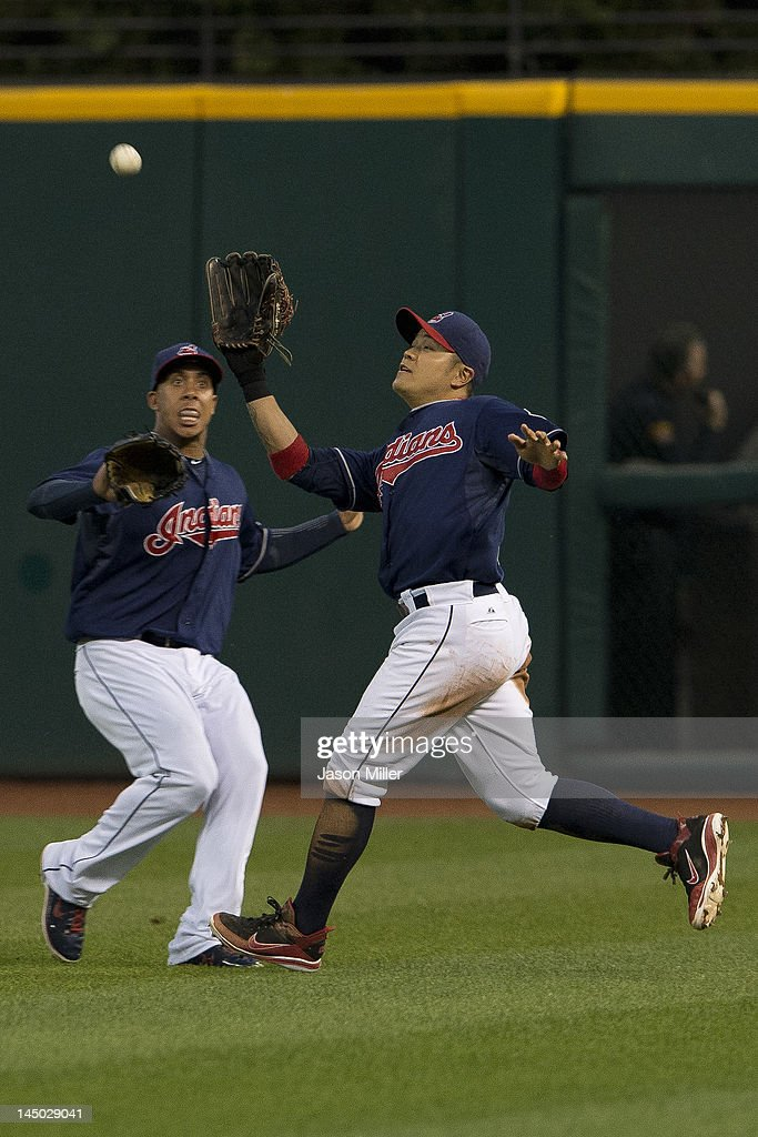Center fielder Michael Brantley #23 and right fielder <a gi-track='captionPersonalityLinkClicked' href=/galleries/search?phrase=Shin-Soo+Choo&family=editorial&specificpeople=196543 ng-click='$event.stopPropagation()'>Shin-Soo Choo</a> #17 of the Cleveland Indians nearly collide as Choo makes the catch during the sixth inning against the Detroit Tigers at Progressive Field on May 22, 2012 in Cleveland, Ohio.