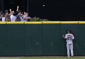 Center fielder Michael Brantley of the Cleveland Indians watches a tworun homer by Michael Saunders of the Seattle Mariners at Safeco Field on August...