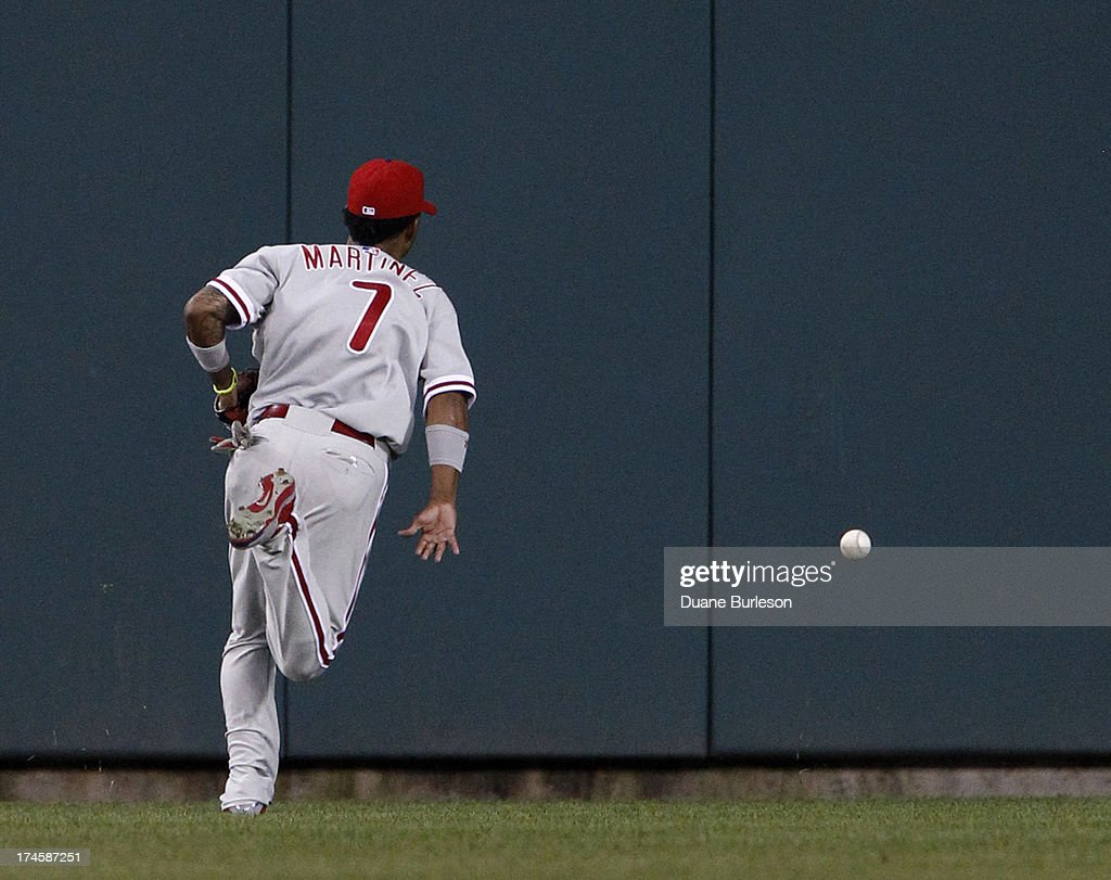 Center fielder Michael Martinez #7 of the Philadelphia Phillies chases down a double hit over his head by Victor Martinez of the Detroit Tigers in the fourth inning at Comerica Park on July 27, 2013 in Detroit, Michigan.